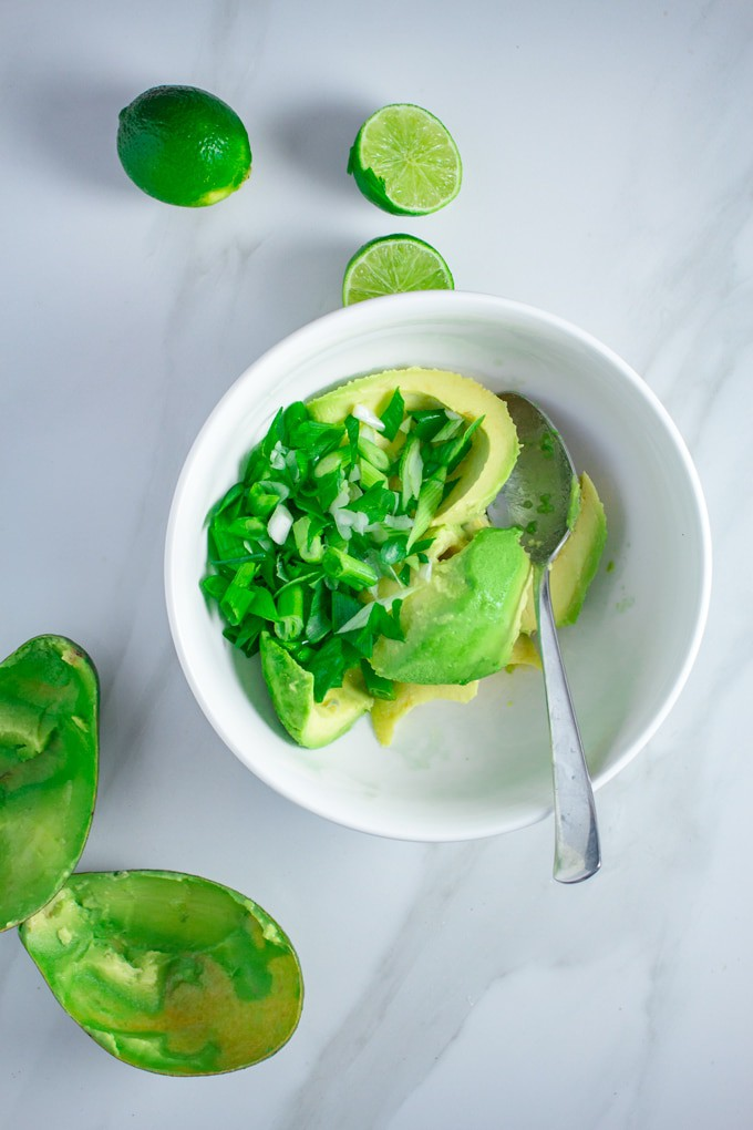 Keto Guacamole Recipe   This easy Guacamole Recipe is Made using Caribbean Avocados, full-fat Sour cream and crunch green onions. It will blow your sock off! #keto #recipe #ketorecipes #easyrecipes #lowcarb