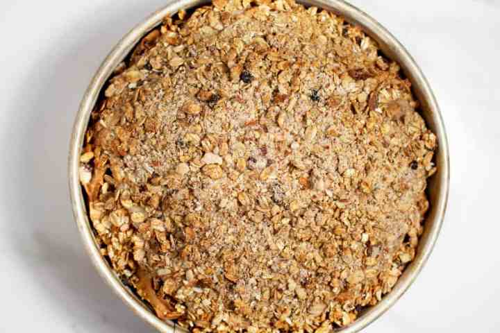 Baked apple crumb cake in cake tin