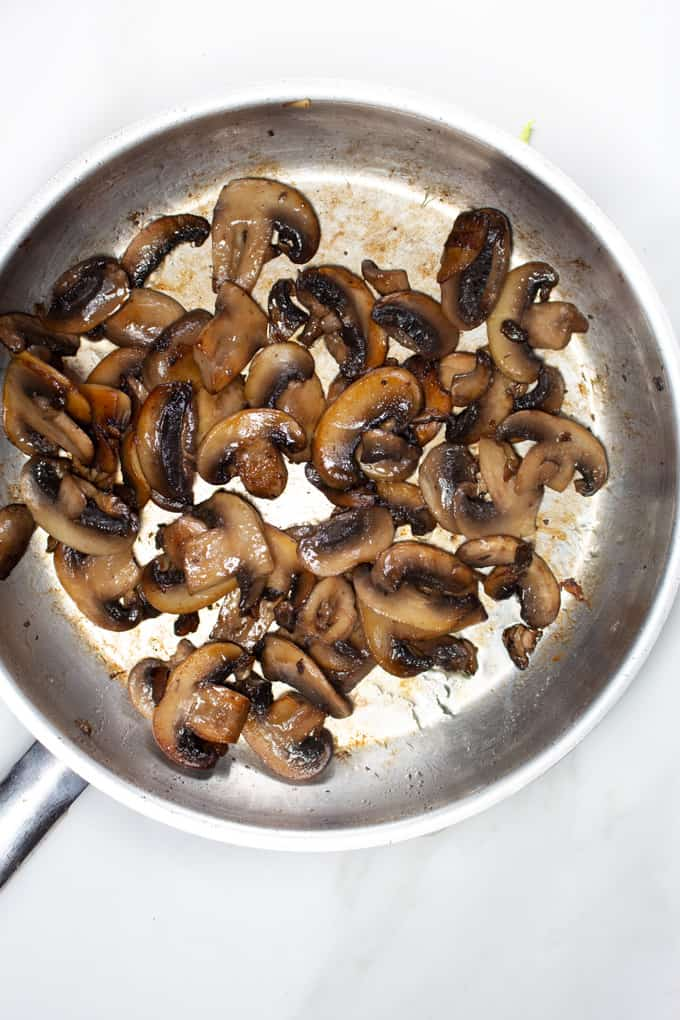 Cooked cremini mushrooms in a skillet