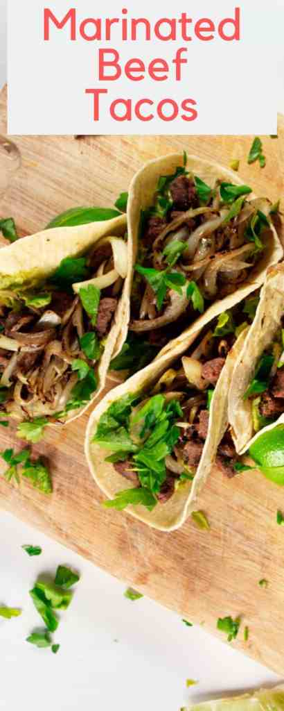 If you find yourself craving a satisfying meaty taco, this is the recipe for you. Served with guacamole, caramelized onions and fresh lime. Divine! #marinated #taco #beef #dinner #easy #recipe