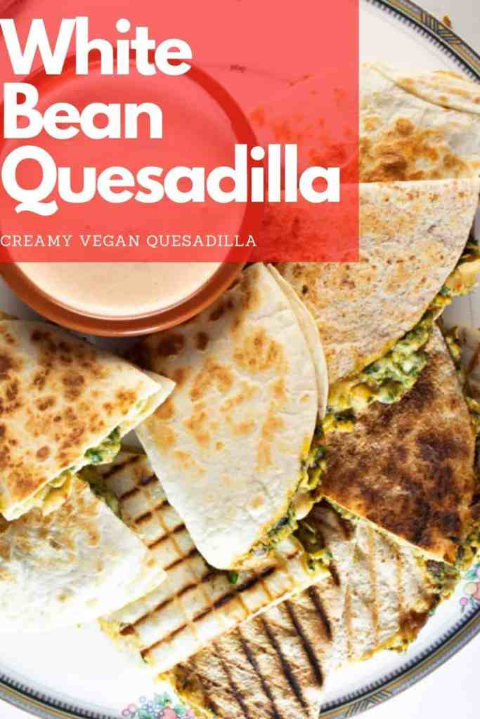 Easy, Quick and Delicious. That's the trifecta this vegan quesadilla brings on to the table. The filling is comprised of white beans, spinach, vegan Queso and vegan grated cheddar. #vegan #quesadilla #creamy #recipe #easy #dairy-free
