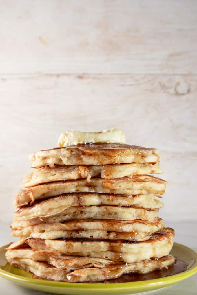 Sourdough pancakes served with butter and maple syrup