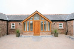 Front Oak Porch to Sandstone Cottage