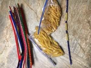 Pipe Cleaners and Pasta- -You can't get much simpler than this! Bag up a few different dry pasta shapes and a bundle of pipe cleaners. Let the child practice stringing pasta either to make jewelry or just for fun.