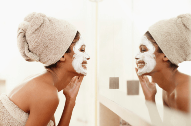 woman-applying-mask-to-face