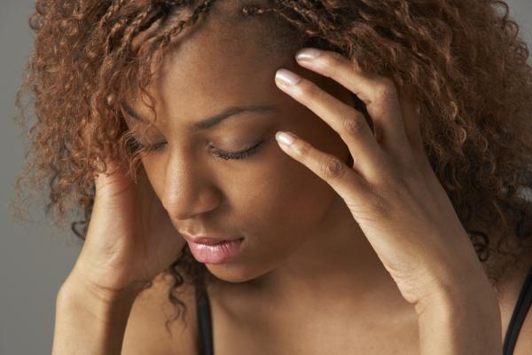 Studio Portrait Of Stressed Teenage Girl