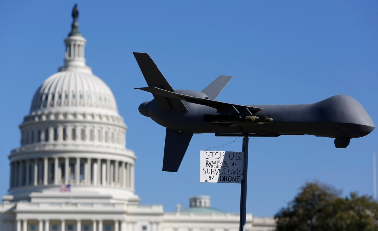 "Reuters/Jonathan Ernst - Demonstrators deploy a model of a U.S. drone aircraft at the ""Stop Watching Us: A Rally Against Mass Surveillance"" near the U.S. Capitol in Washington, October 26, 2013"
