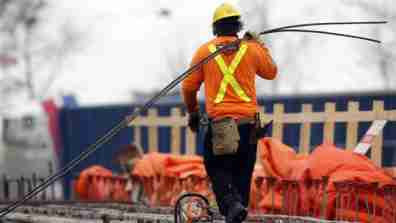 A worker walks at a bridge under construction.