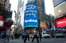 Digital billboard announces Facebook's initial public offering in New York.