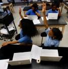 Students raise hands