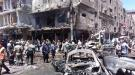 Men and Syrian Army members inspect a damaged site after a suicide and car bomb attack in south Damascus Shi'ite suburb of Sayeda Zeinab, Syria in this handout picture provided by SANA on June 11, 2016. SANA