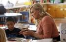 A teacher helping a student.