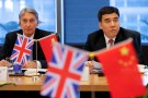 Britain's Chancellor of the Exchequer, Philip Hammond (L) and Bank of China Chairman Tian Guoli attend UK-China High Level Financial Services Roundtable at the Bank of China head office building in Beijing, China July 22, 2016. REUTERS/Damir Sagolj