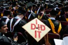 "Graduating student Katherine Thomas has ""I Did It"" written on her mortar board during Commencement"