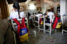 Backpacks with the colours of the Venezuelan national flag hang on chairs during a class at an improvised classroom above a state-run supermarket, which is part of state school Monsenor Marco Tulio Ramirez Roa, in La Fria, Venezuela, June 1, 2016.