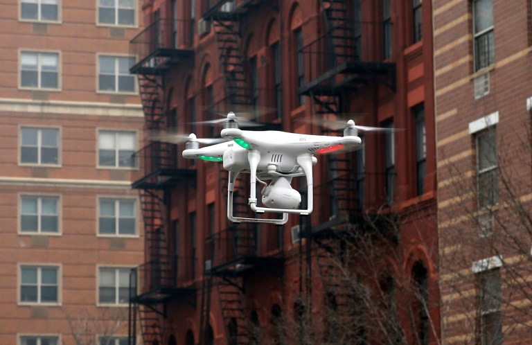 A camera drone flown by Brian Wilson flies near the scene where two buildings were destroyed in an explosion, in the East Harlem section in New York City, March 12, 2014. REUTERS/Mike Segar