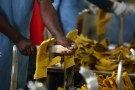 A worker steams a gloves in Pittards world class leather manufacturing company in Ethiopia's capital Addis Ababa, March 22, 2016. Picture taken March 22, 2016. REUTERS/Tiksa Negeri  - RTSDHG9