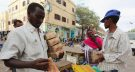 Dealers carry bundles of Somalian currency (shillings) from at an open forex bureau along Hamarweyne district of in Somalia's capital Mogadishu, January 27, 2016. Picture taken January 27, 2016. To match SOMALIA-ECONOMY/ REUTERS/Feisal Omar - RTX25GVD