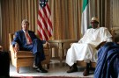 "U.S Secretary of State John Kerry (L) sits beside Nigeria's former military ruler and opposition party All Progressives Congress (APC) presidential candidate Muhammadu Buhari at the U.S. consulate house in Lagos January 25, 2015. Kerry was in Nigeria to urge its rival political camps to respect the outcome of a Feb. 14 presidential election. Washington is concerned that post-poll violence could undermine the stability of Africa's top oil producer and hamper efforts to tackle the Islamist militants of Boko Haram. ""Given the stakes it's absolutely critical that these elections are conducted peacefully,"" Kerry told reporters in the commercial capital Lagos after meeting President Goodluck Jonathan and main opposition rival Buhari. REUTERS/Akintunde Akinleye (NIGERIA - Tags: POLITICS ELECTIONS) - RTR4MUE9"