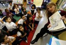 Teacher Audrey Benes speaks to her kindergarten class at Walsh Elementary School in Chicago, Illinois