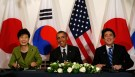 U.S. President Barack Obama participates in a tri-lateral meeting with President Park Geun-hye of the South Korea (L) and Prime Minister Shinzo Abe of Japan (R)