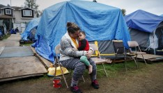 Kadee Ingram, 28, holds her son Sean, 2, at SHARE/WHEEL Tent City 3 outside Seattle, Washington October 13, 2015. REUTERS/Shannon Stapleton/File Photo GLOBAL BUSINESS WEEK AHEAD PACKAGE - SEARCH 'BUSINESS WEEK AHEAD MAY 30' FOR ALL IMAGES - RTX2ERCA