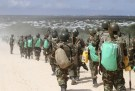Picture of African Union Mission in Somalia peacekeepers and a refugee camp.