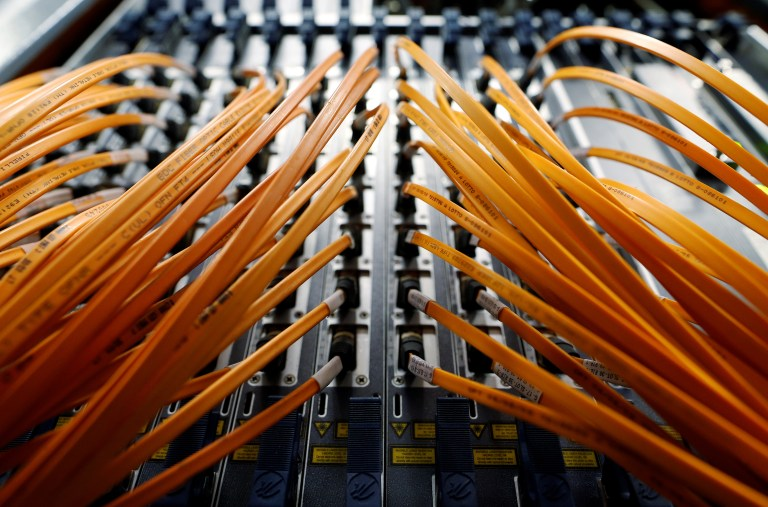 Optical fibre cables of Telecom Italia are seen in a telephone exchange in Rome, Italy December 20, 2013. REUTERS/Alessandro Bianchi/File Photo - RTX2EGX0