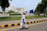 A man walks past the Supreme Court building in Islamabad, Pakistan. REUTERS/Faisal Mahmood