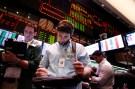 A trader looks at his screen