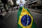 A demonstrator wears a Guy Fawkes mask and a Brazilian flag during a protest on the streets near the Maracana stadium in Rio de Janeiro June 30, 2013. Tens of thousands of Brazilians have taken to the streets this month in the biggest protests in 20 years, fuelled by an array of grievances ranging from poor public services to the high cost of World Cup soccer stadiums and corruption.  REUTERS/Lunae Parracho (BRAZIL - Tags: SPORT SOCCER CIVIL UNREST CRIME LAW TPX IMAGES OF THE DAY) - RTX117C1