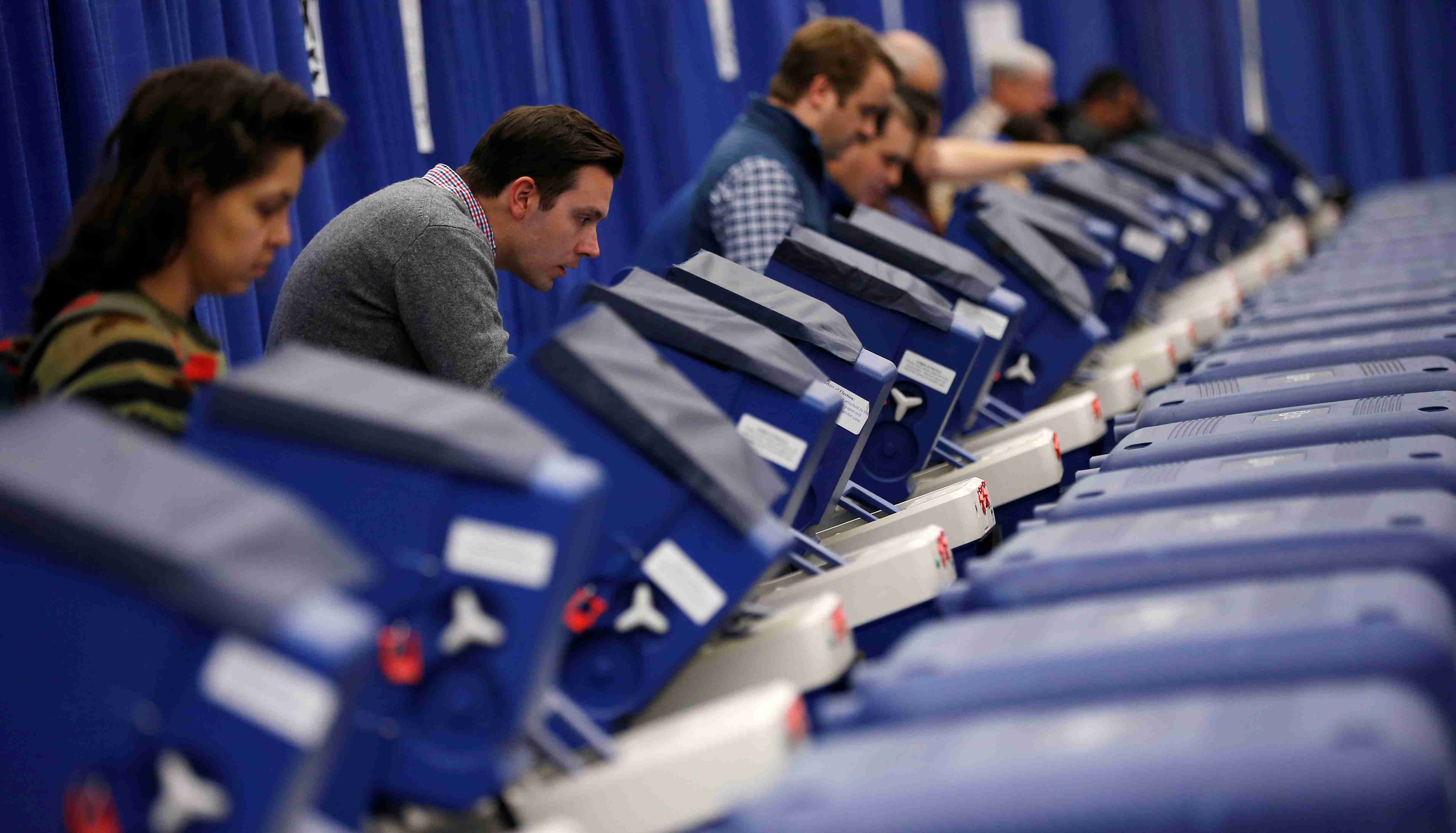 Voters cast their ballots during early voting in Chicago, Illinois, U.S.