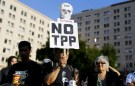 Demonstrators attend a rally against the Trans-Pacific Partnership (TPP) trade deal in front of the government house at Santiago, Chile, February 4, 2016. REUTERS/Ivan Alvarado - RTX25IVG