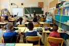 Elementary school children are seen in a classroom on the first day of class in the new school year in Nice, September 3, 2013.