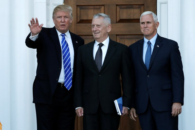 U.S. President-elect Donald Trump (L) and Vice President-elect Mike Pence (R) greet retired Marine General James Mattis for a meeting at the main clubhouse at Trump National Golf Club in Bedminster, New Jersey, U.S., November 19, 2016. REUTERS/Mike Segar - RTSSFDG
