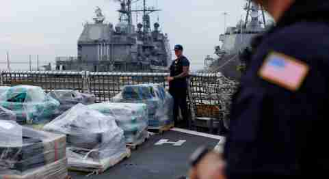 Armed U.S. Coast Guardsmen aboard the Coast Guard Cutter Waesche stand watch as more than 39,000 pounds of seized cocaine is offloaded at Naval Base San Diego, California, U.S., October 27, 2016. REUTERS/Mike Blake - RTX2QRU3