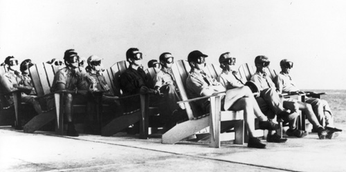 VIP observers sitting on the patio of the Officer's Beach Club on Parry Island are illuminated by the 81 kiloton Dog test, part of Operation Greenhouse, at Enewetak Atoll, April 8, 1951.