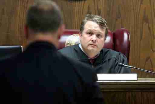 A judge listens to a lawyer.