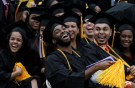 Graduating students of the City College of New York laugh together during the College's commencement ceremony in the Harlem section of Manhattan, New York, U.S., June 3, 2016. REUTERS/Mike Segar - RTX2FKNB