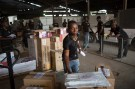 An employee of online retailer Jumia sorts packages for delivery at the company's warehouse in Lagos February 16, 2015. The growth of Africa's middle class has created demand for products that conventional retail struggles to satisfy due to a shortage of malls and grinding traffic in many cities that deters shoppers. The sector is still in its infancy. The internet's contribution to Africa's gross domestic product stood at 1.1 percent in 2013, much lower than other emerging markets. But this could rise to 10 percent, or $300 billion, by 2025, according to a report by consultants McKinsey's & Company. REUTERS/Joe Penney (NIGERIA - Tags: BUSINESS SOCIETY EMPLOYMENT) - RTR4PSUQ