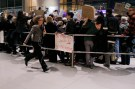 Immigration attorney Susan Church runs past demonstrators protesting U.S. Donald Trump's sweeping immigration executive order in the International Arrivals area of Logan Airport in Boston, Massachusetts, U.S., January 28, 2017. Picture taken January 28, 2017  REUTERS/Brian Snyder - RTSY34S