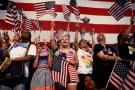 Supporters of Democratic U.S. presidential candidate Hillary Clinton cheer during her California primary night rally held in the Brooklyn borough of New York