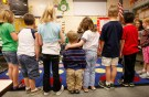 First grader Adam Kotzian (C) does a spelling drill with classmates in his classroom at Eagleview Elementary school in Thornton, Colorado March 31, 2010.