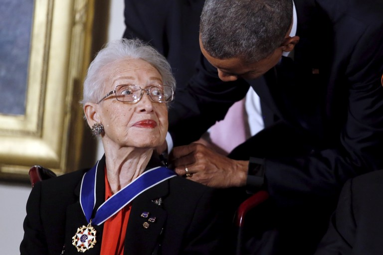 U.S. President Barack Obama presents the Presidential Medal of Freedom to NASA mathematician Katherine G. Johnson during an event in the East Room of the White House in Washington November 24, 2015. Johnson is a pioneer in American space history. REUTERS/Carlos Barria - RTX1VP9Z