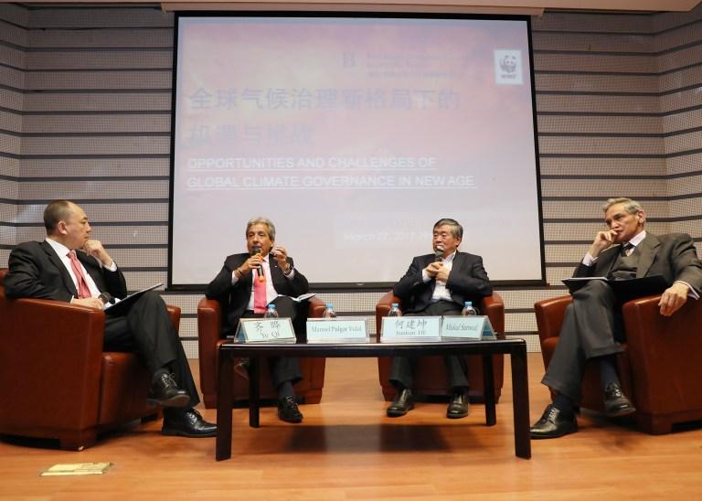QI Ye, Manuel Pulgar-Vidal , HE Jiankun and Mukul Sanwal on the panel discussion.