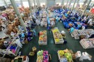 Employees work extra hours to pack products at a factory during the 11.11 shopping festival, in Taicang, Jiangsu province.
