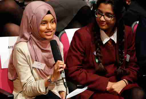 Ayesha Begum, 17 asks a question to the First Lady of the United States Michelle Obama, via a video link at the Mulberry School for Girls in London, Britain October 11, 2016. 'A Brighter Future: A Global Conversation on Girls? Education' was a digital conversation with adolescent girls around the world. The event took place in celebration of International Day of the Girl. Girls in Washington, D.C., Jordan, Peru, Tanzania, and the Mulberry School for Girls in the United Kingdom spoke with one another about the challenges they have faced and potentially overcome in attaining an education. REUTERS/Kirsty Wigglesworth/Pool - RTSRT6X