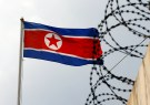 The North Korea flag flutters next to concertina wire at the North Korean embassy in Kuala Lumpur, Malaysia March 9, 2017. REUTERS/Edgar Su - RTS122QZ