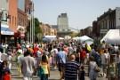A street festival in Ames Iowa at their Main Street Cultural District