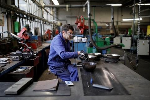 An employee works at the Duralex International glass factory in La Chapelle-Saint-Mesmin, near Orleans